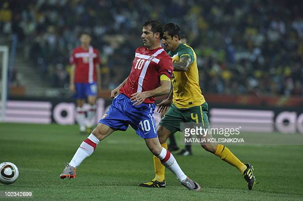 Serbia's midfielder Dejan Stankovic fights for the ball with Australia's striker Tim Cahill during the Group D first round 2010 World Cup football...