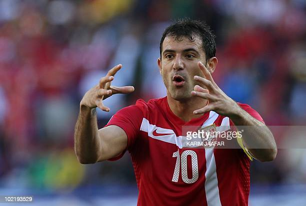 Serbia's midfielder Dejan Stankovic gestures during the Group D first round 2010 World Cup football match Germany vs. Serbia on June 18, 2010 at...