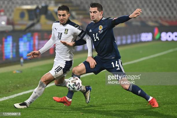Serbia's midfielder Dusan Tadic fights for the ball with Scotland's midfielder Kenny McLean during the Euro 2020 play-off qualification football...