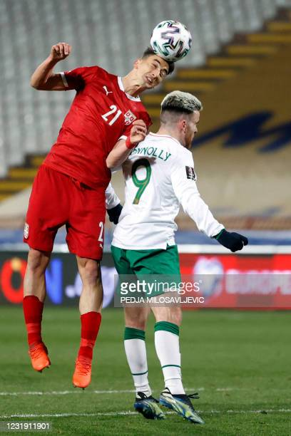 Serbia's midfielder Filip Djuricic fights for the ball with Ireland's forward Aaron Connolly during the FIFA World Cup Qatar 2022 Group A...