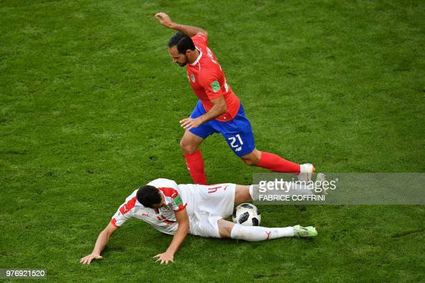 Serbia's midfielder Luka Milivojevic vies for the ball with Costa Rica's forward Marco Urena during the Russia 2018 World Cup Group E football match...
