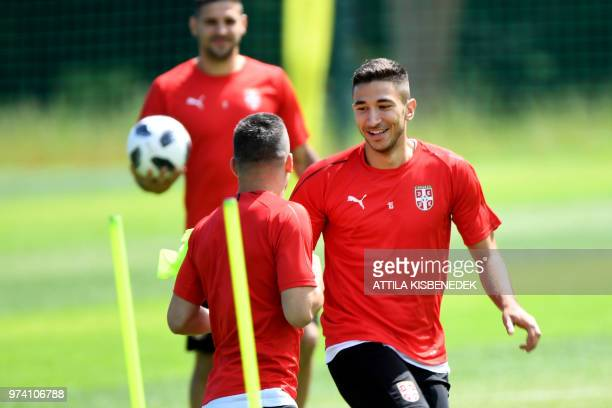 Serbia's midfielder Marko Grujic plays tag with his teammates during a training session at their base camp in Svetlogorsk some 50 km north of...