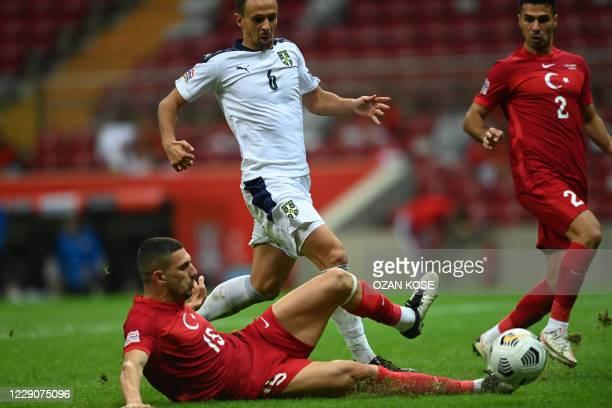 Serbia's midfielder Nemanja Maksimovic is challend by Turkey's defender Merih Demiral and midfielder Zeki Celik during the UEFA Nations League group...