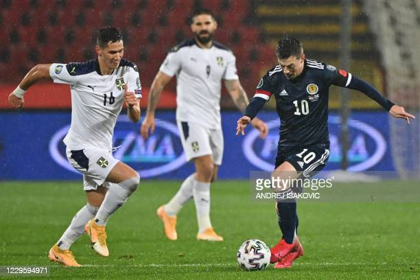 Serbia's midfielder Sasa Lukic fights for the ball with Scotland's midfielder Callum McGregor during the Euro 2020 play-off qualification football...