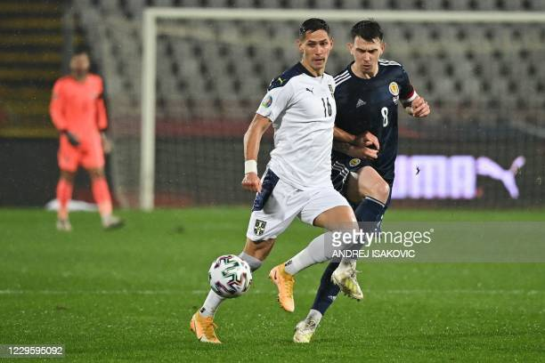 Serbia's midfielder Sasa Lukic fights for the ball with Scotland's midfielder Ryan Jack during the Euro 2020 play-off qualification football match...