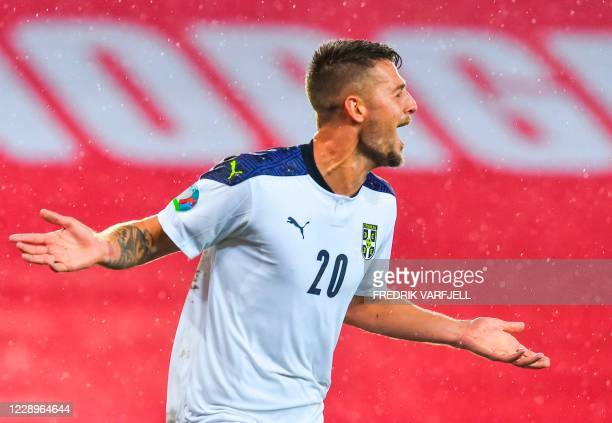 Serbia's midfielder Sergej Milinkovic-Savic celebrates after scoring a second goal during the Euro 2020 play-off semi-final football match between...