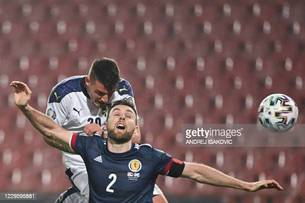 Serbia's midfielder Sergej Milinkovic-Savic fights for the ball with Scotland's defender Stephen O'Donnell during the Euro 2020 play-off...