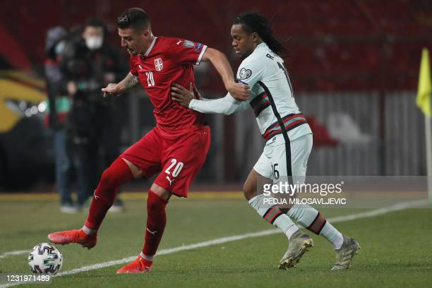 Serbia's midfielder Sergej Milinkovic-Savic fights for the ball with Portugal's midfielder Renato Sanches during the FIFA World Cup Qatar 2022...