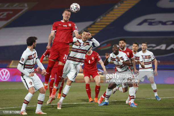 Serbia's midfielder Sergej Milinkovic-Savic heads the ball during the FIFA World Cup Qatar 2022 qualification Group A football match between Serbia...