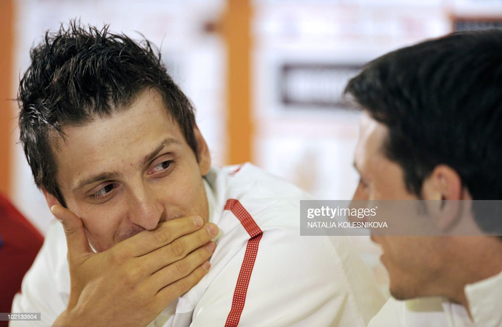 Serbia's midfielder Zdravko Kuzmanovic (L) speaks to teammate Gojko Kacar during a press conference at the hotel in Johannesburg, on June 16, 2010 during the 2010 World Cup in South Africa.