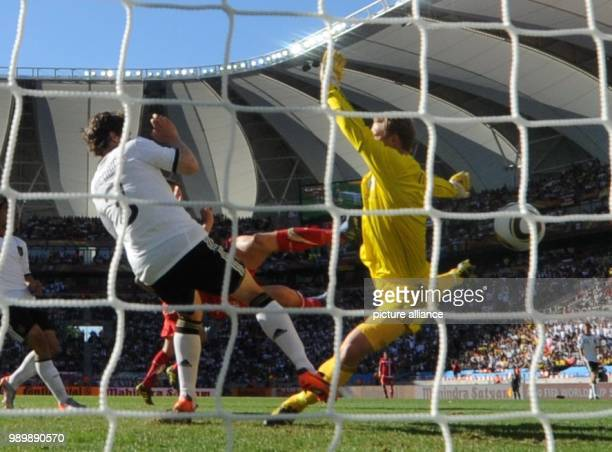 Serbia's Milan Jovanovic beats Germany's goalkeeper Manuel Neuer and Arne Friedrich to score the 0-1 during the 2010 FIFA World Cup group D match...