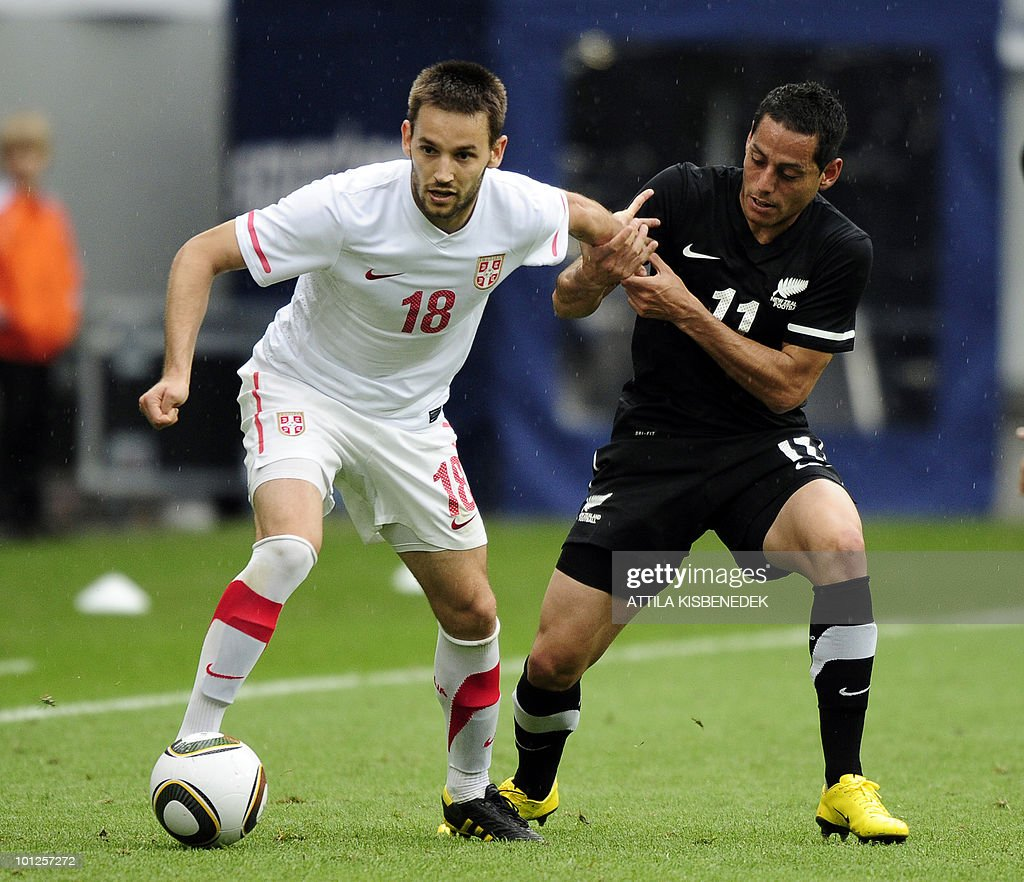 Serbia's Milos Ninkovic (L) is held by New Zealand's Leo Bertos (R) during their friendly match in the Hypo Arena Wörthersee Stadium of Klagenfurt on May 29, 2010 prior to the FIFA World Cup 2010 hosted by South Africa between June 11 and July 11.