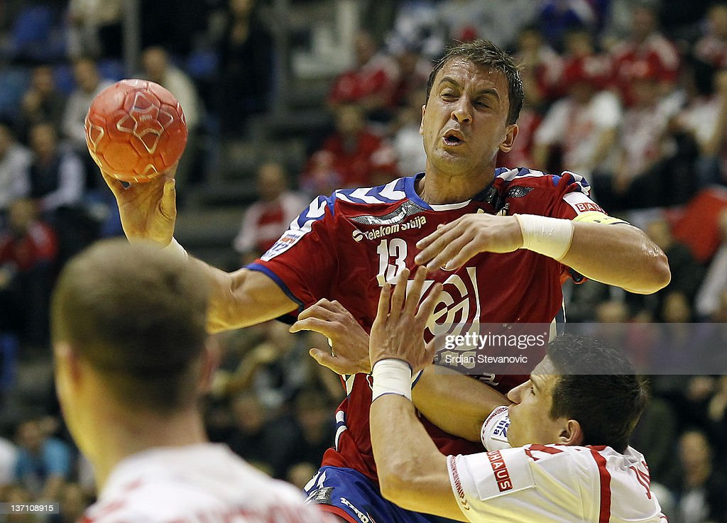 Serbia's Momir Ilic (L) in action against Poland Patryk Kuchczynski (R) and Mihal Jurecki during the Men's European Handball Championship group A match between Poland and Serbia at Pionir Sports Centre on January 15, 2011 in Belgrade, Serbia.