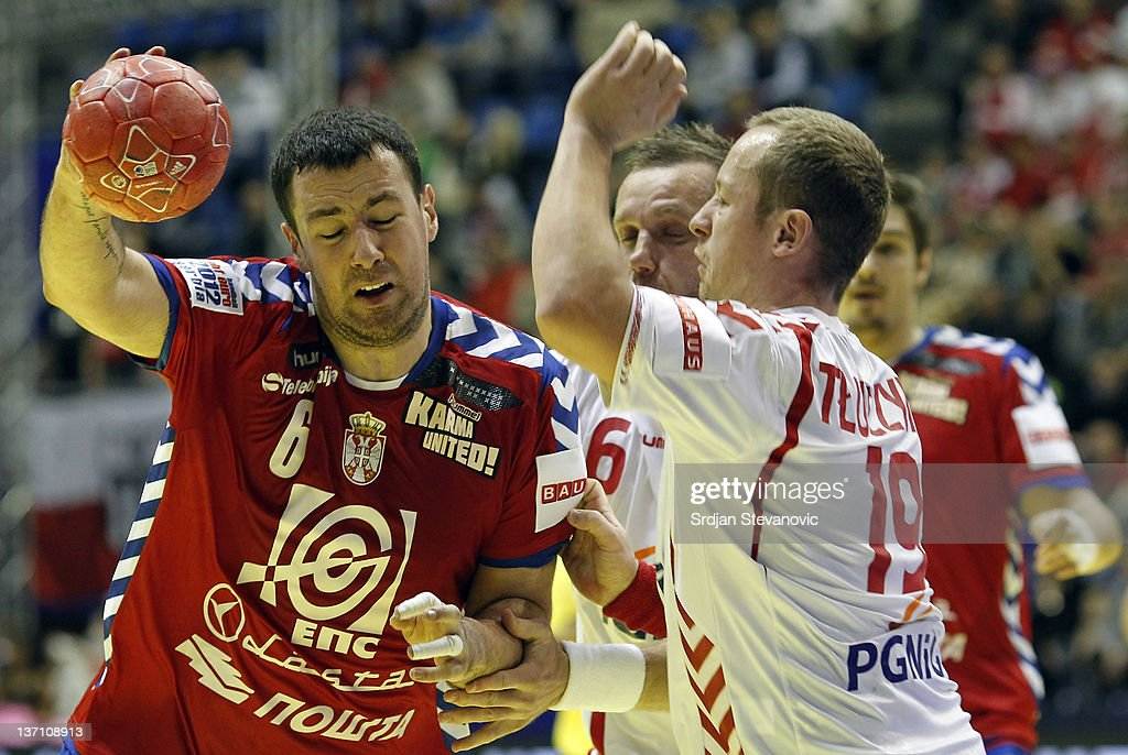 Serbia's Momir Ilic (L) in action against Poland Tomasz Tluczynski (R) during the Men's European Handball Championship group A match between Poland and Serbia at Pionir Sports Centre on January 15, 2011 in Belgrade, Serbia.