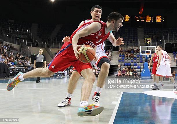 Serbia's national basketball team player Stefan Markovic vies with Georgia's national basketball team player Beka Burjanadze during the friendly...