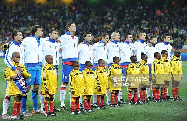 Serbia's national football team players listen to their national anthem prior to the start of the Group D first round 2010 World Cup football match...