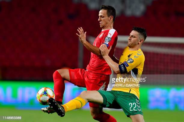 Serbias Nemanja Maksimovic vies with Lithuania's Fiodor Cernych during the Euro 2020 football qualification match between Serbia and Lithuania at the...