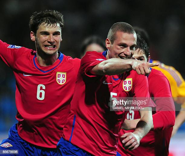 Serbia's Nemanja Vidic celebrates after he scored 2-0 against Romania during the World Cup 2010 Group 7 qualifiers football match in Constanta city...