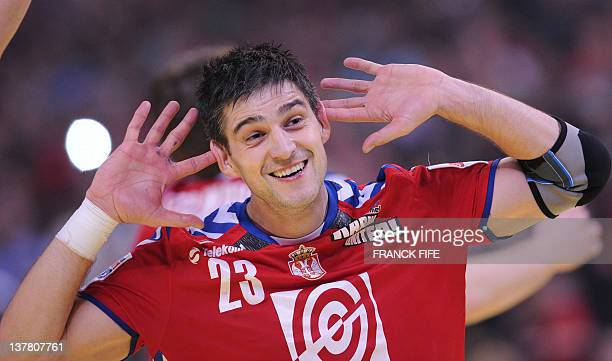 Serbia's Nenad Vuckovic celebrates after winning during the men's EHF Euro 2012 Handball Championship semifinal match Serbia vs Croatia on January 27...