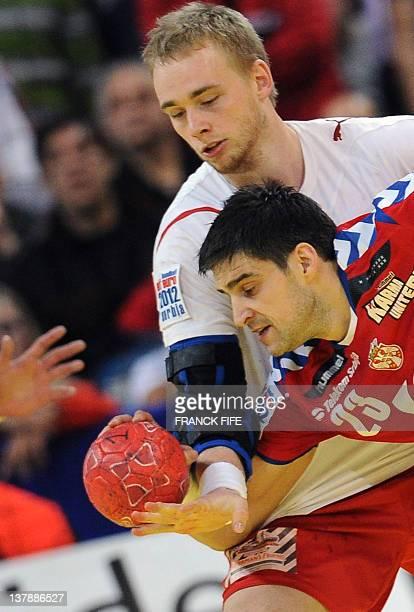 Serbia's Nenad Vuckovic vies with Denmark's René Toft Hansen during the men's EHF Euro 2012 Handball Championship final Serbia vs Denmark on January...