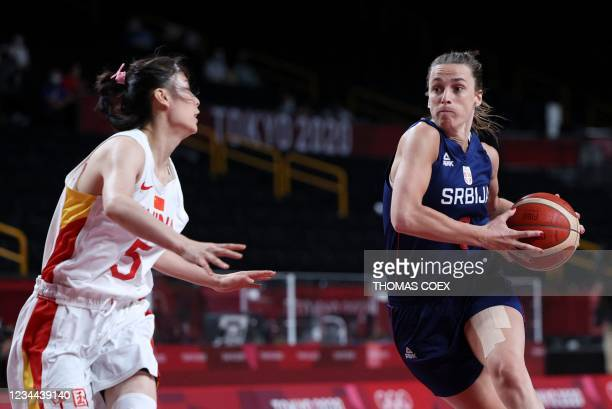 Serbia's Nevena Jovanovic goes to the basket past China's Wang Siyu in the women's quarter-final basketball match between China and Serbia during the...