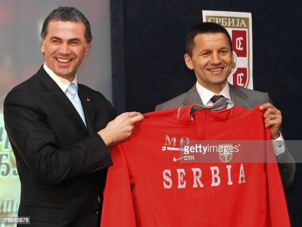 Serbia's new coach Miroslav Djukic poses for photographers with the President of Serbia's Football Federation Zvezdan Terzic in Belgrade 25 December...