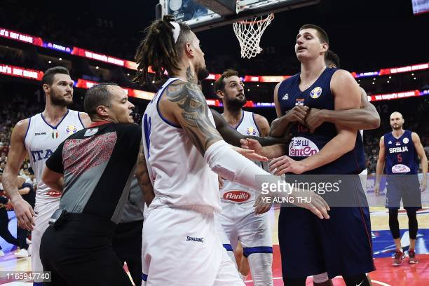 Serbia's Nikola Jokic confronts the Italian players during the Basketball World Cup Group D game between Italy and Serbia in Foshan on September 4...