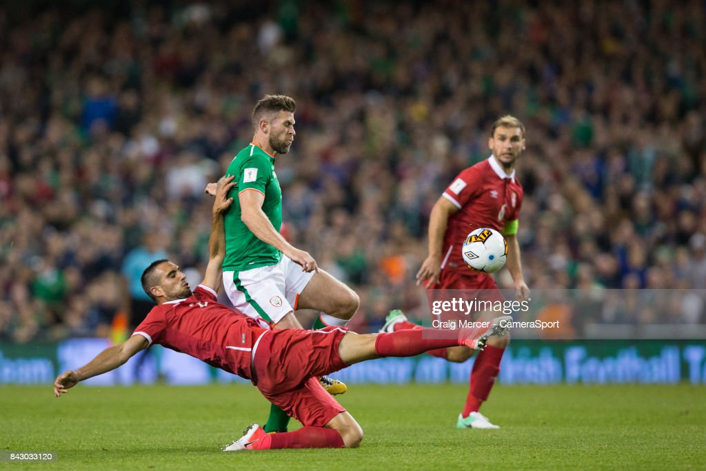 Serbias Nikola Maksimovic is shown a red card for this challenge on Republic of Ireland's Daryl Murphy during the FIFA 2018 World Cup Qualifier between Republic of Ireland and Serbia at Aviva Stadium on September 5, 2017 in Dublin, .