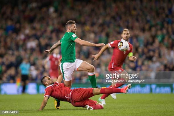 Serbias Nikola Maksimovic is shown a red card for this challenge on Republic of Ireland's Daryl Murphy during the FIFA 2018 World Cup Qualifier...