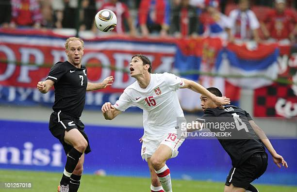 Serbia's Nikola Zigic fights for the ball with NewZealand's Simon Elliot and Winstin Reid during their friendly match between their teams in the Hypo...