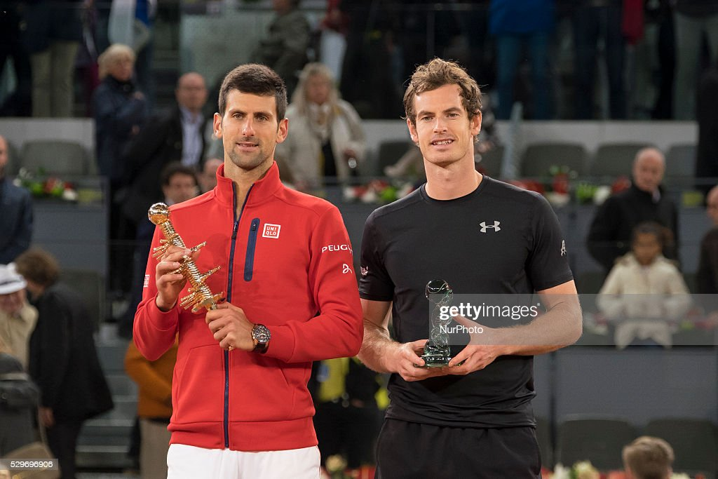Serbia's Novak Djokovic (L) and Britain's Andy Murray pose with their trophies after the Madrid Open men's tennis final at the Caja Magica (Magic Box) sports complex in Madrid on May 8, 2016.