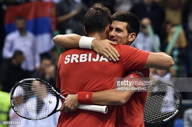 Serbia's Novak Djokovic and Nenad Zimonjic celebrate after winning their double tennis match against Croatia's Marin Draganja and Franko Skugor...
