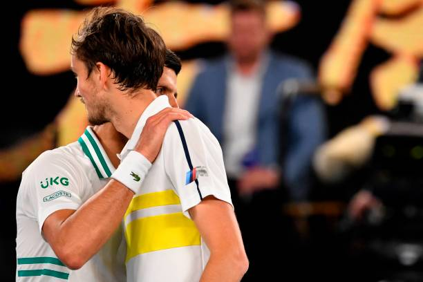 Serbia's Novak Djokovic and Russia's Daniil Medvedev greet each other after their men's singles final match on day fourteen of the Australian Open...