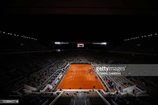 Serbia's Novak Djokovic and Spain's Pablo Carreno Busta seat on the bench during their men's singles quarter-final tennis match at the Philippe...