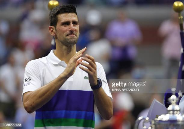 Serbia's Novak Djokovic applauds the crowd after losing to Russia's Daniil Medvedev during their 2021 US Open Tennis tournament men's final match at...