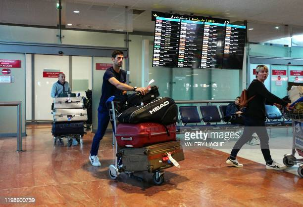 Serbia's Novak Djokovic arrives at Nice's airport southern France on February 4 two days after winning the men's singles final match of the...