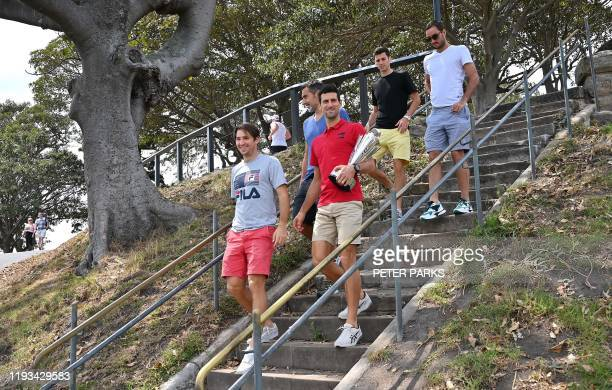 Serbia's Novak Djokovic arrives with coach Nenad Zimonjic and players Dusan Lajovic Nikola Cacic and Viktor Troicki with the ATP Cup for a photo...