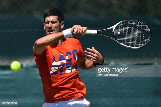 TOPSHOT Serbia's Novak Djokovic attends a practice session at The All England Tennis Club in Wimbledon southwest London on July 2 on the eve of the...