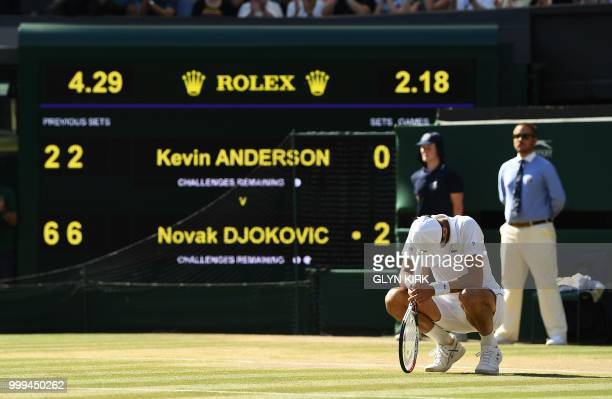 Serbia's Novak Djokovic celebrates after beating South Africa's Kevin Anderson 62 62 76 in their men's singles final match on the thirteenth day of...