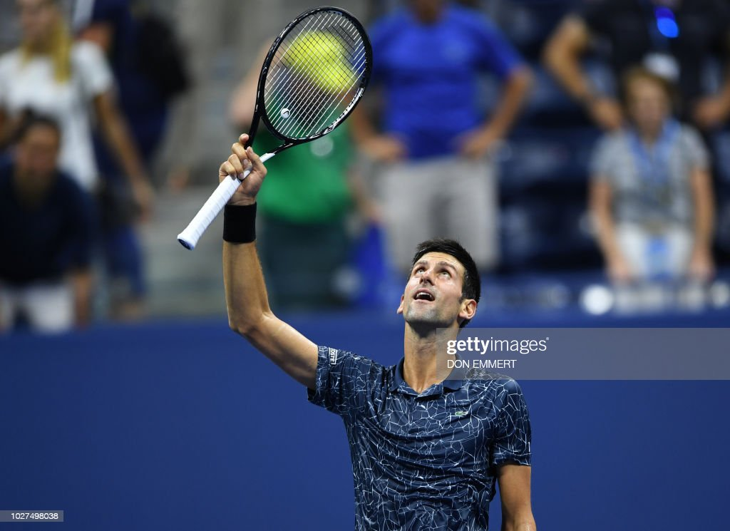 Serbia's Novak Djokovic celebrates after defeating Australia's John Millman in their Men's Singles Quarter-Finals tennis match at the 2018 US Open at the USTA Billie Jean King National Tennis Center in New York on September 5, 2018. - Two-time champion Novak Djokovic ended John Millman's fairytale US Open run on Wednesday, beating the 55th-ranked Australian in straight sets to book a semi-final clash with Kei Nishikori.
