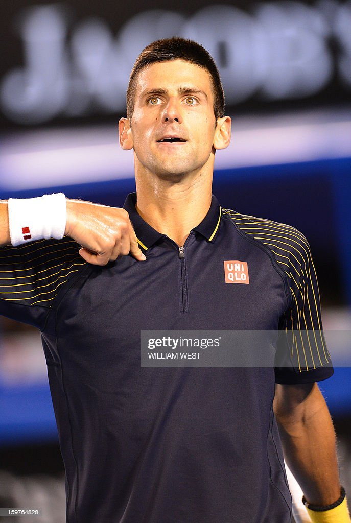 Serbia's Novak Djokovic celebrates after victory in his men's singles match against Switzerland's Stanislas Wawrinka on the seventh day of the Australian Open tennis tournament in Melbourne early January 21, 2013.