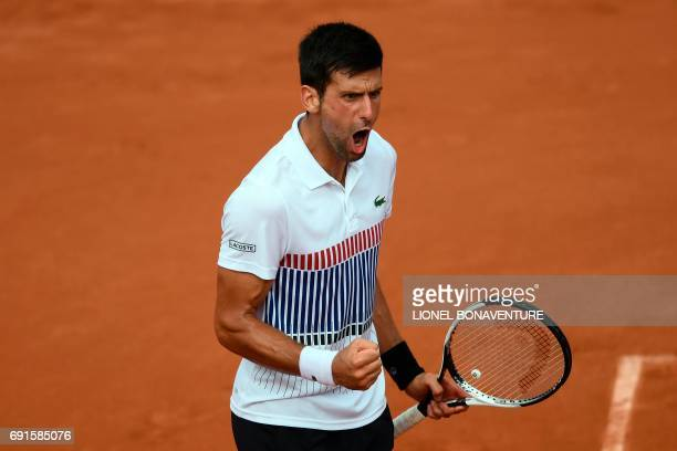 Serbia's Novak Djokovic celebrates after winning against Argentina's Diego Schwartzman during their tennis match at the Roland Garros 2017 French...