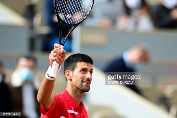 Serbia's Novak Djokovic celebrates after winning against Lithuania's Ricardas Berankis during their men's singles second round tennis match on Day 5...