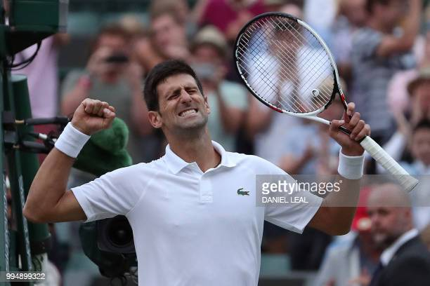 Serbia's Novak Djokovic celebrates after winning against Russia's Karen Khachanov during their men's singles fourth round match on the seventh day of...