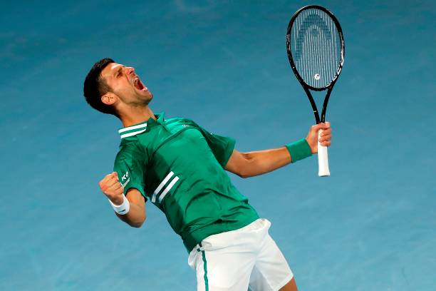 Serbia's Novak Djokovic celebrates after winning against Taylor Fritz of the US during their men's singles match on day five of the Australian Open...