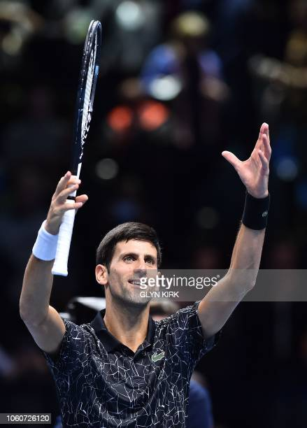 Serbia's Novak Djokovic celebrates after winning against US player John Isner during their men's singles roundrobin match on day two of the ATP World...