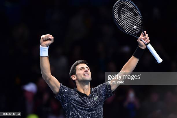 TOPSHOT Serbia's Novak Djokovic celebrates after winning against US player John Isner during their men's singles roundrobin match on day two of the...