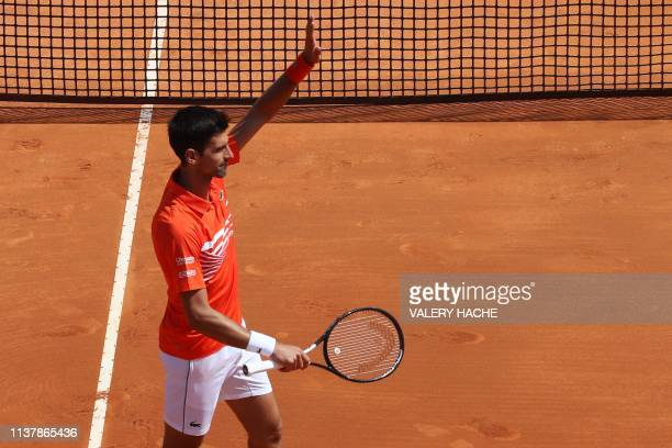 Serbia's Novak Djokovic celebrates after winning against US Taylor Fritz during their tennis match on the day 6 of the Monte-Carlo ATP Masters Series...