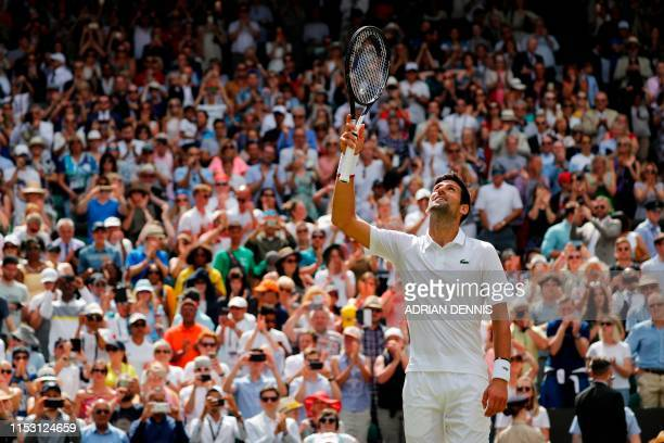 Serbia's Novak Djokovic celebrates after winning Germany's Philipp Kohlschreiber during their men's singles first round match on the first day of the...