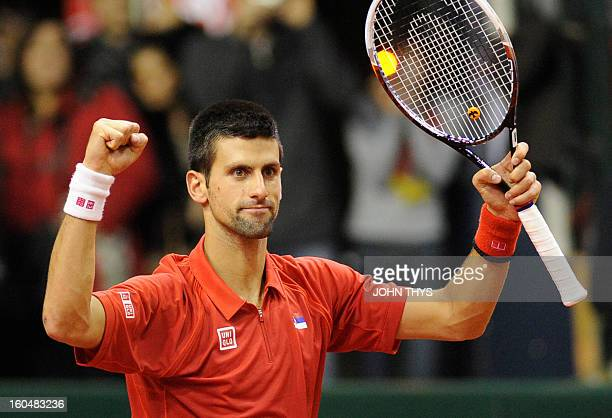 Serbia's Novak Djokovic celebrates after winning his Davis Cup World Group first round tennis match against Belgium's Olivier Rochus on February 1...